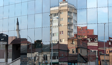 Prishtina building mirroring in a glass facade