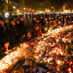 Dozens of mourning people captured during civil service in remembrance of November 2015 Paris attacks victims. Western Europe France Paris place de la République November 15 2015